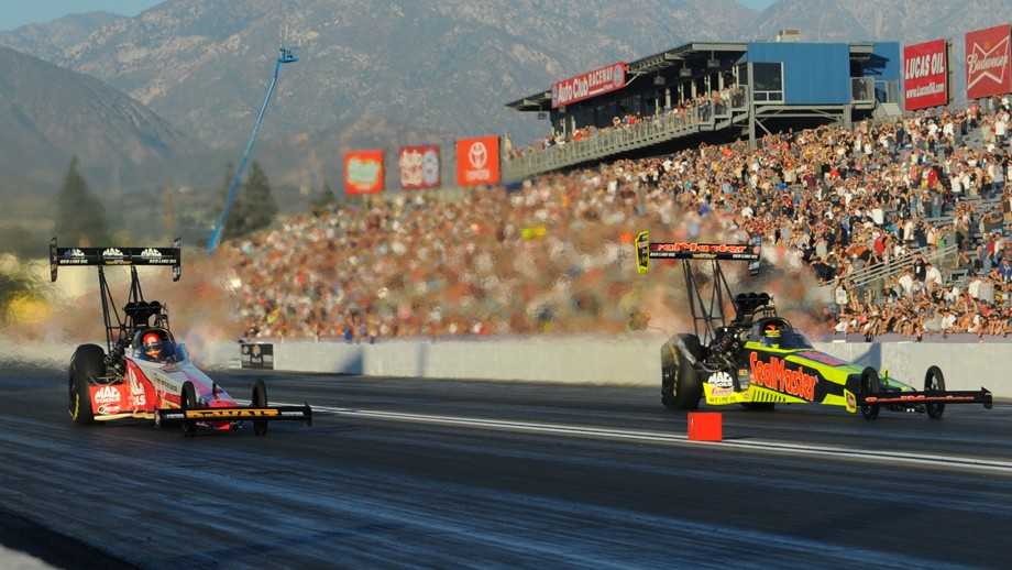 NHRA dragsters on track